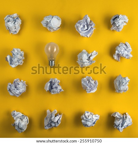 Crumpled paper balls and blank sheet of paper with pen on yellow background. Paper wad. Creativity problems. Searching ideas. - stock photo