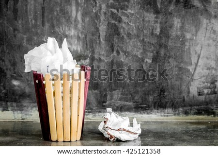 Crumpled paper in the trash can,recycle - stock photo