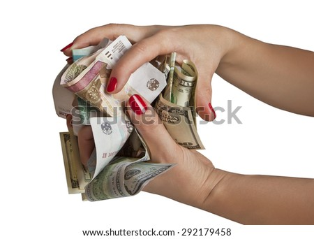 Crumpled paper money in the hands of a woman - stock photo
