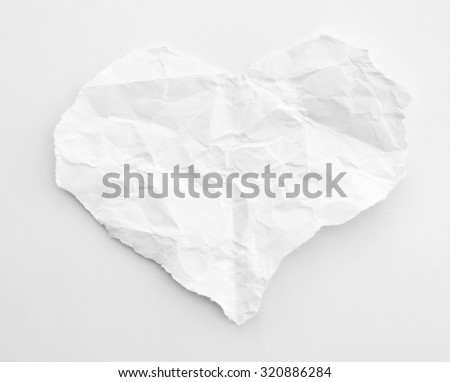 crumpled paper on a white background. Crumpled paper in heart shape - stock photo