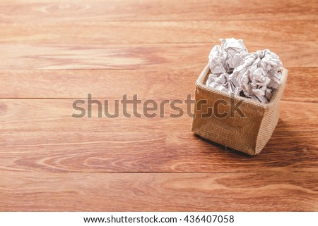 Crumpled paper on the wooden table and copy space for text or other content. Photo concept for unresolved or solve problem, concept for brainstorming, concept for business background. - stock photo