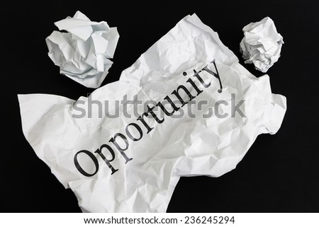 Crumpled paper sheet with word Opportunity isolated on black - stock photo