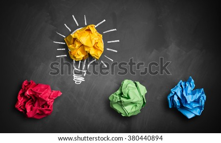 crumpled paper symbolizing different solutions with one highlighted as a light bulb as the right one - stock photo