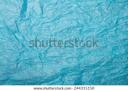 Crumpled paper texture, blue wrapping paper  - stock photo
