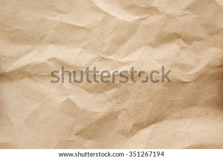 crumpled paper texture for background in sepia light tone:rough and jagged of page paper backdrop:brown and tan colored creased carton wallpaper. - stock photo