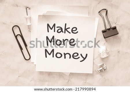 Crumpled paper texture with text make more money on the short note - stock photo