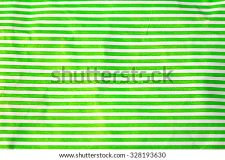 crumpled paper with white and green stripes - stock photo