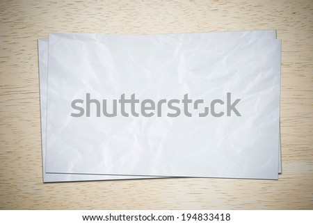 Crumpled papers on wood board. - stock photo