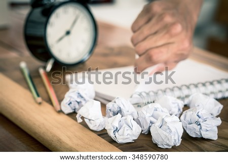 Crumpled papers with hand torn paper as a background , selective focus on crumpled papers - stock photo