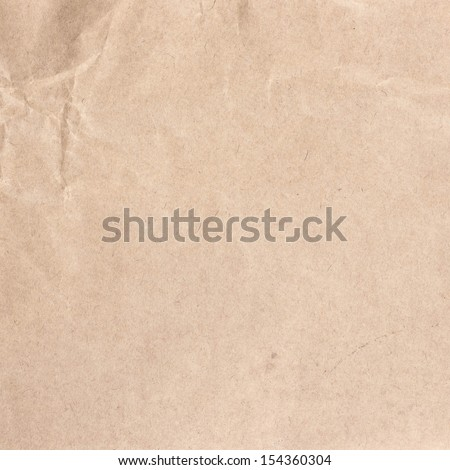 Crumpled recycled paper  texture or background. Vintage craft paper texture. Paper for package. - stock photo