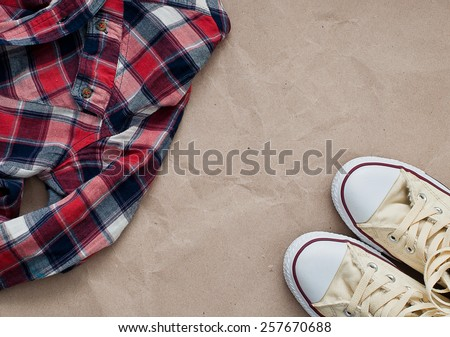 Crumpled red blue checked shirt  and shoes - stock photo