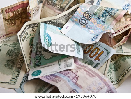 Crumpled scattered Russian rubles and dollars - stock photo