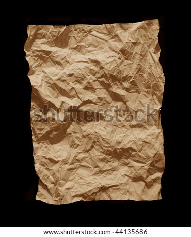 crumpled sheet of paper on a black background