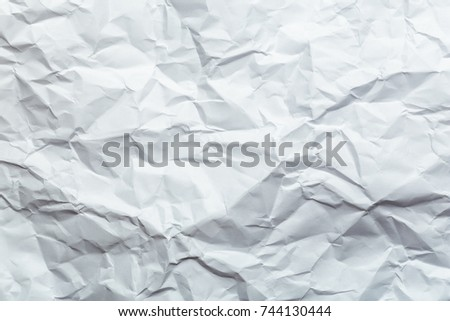 Crumpled white paper background texture for usage in design
