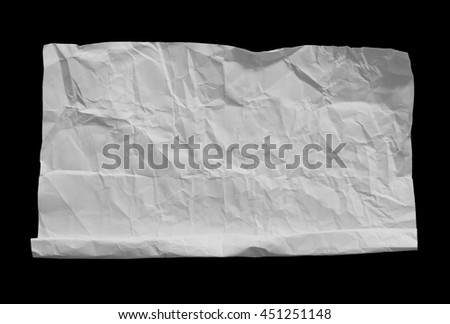 crumpled white paper on black background