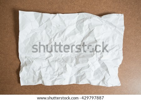 Crumpled White Paper on table