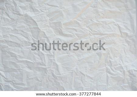 Crumpled white paper textured - stock photo