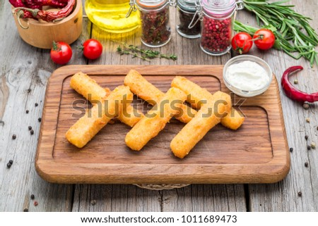 Crunchy Breaded mozzarella cheese sticks with mustard sauce. Beautiful stylish menu. Autumn still life.