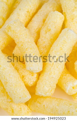 crunchy corn snacks isolated on white