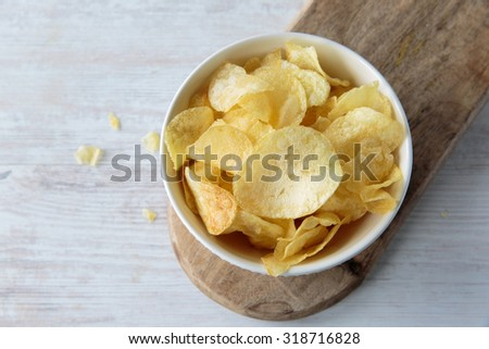 Crunchy delicious potato chips for a tasty snack break - stock photo