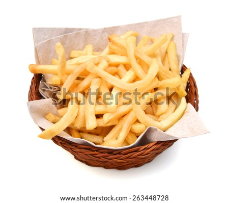 crunchy French fries in basket on white background  - stock photo
