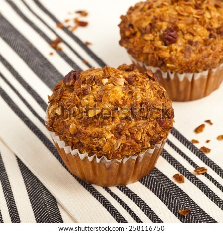 Crunchy Granola Peach Muffins with Butter Pecan Toppings. Selective focus. - stock photo