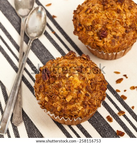 Crunchy Granola Peach Muffins with Butter Pecan Toppings. Selective focus.