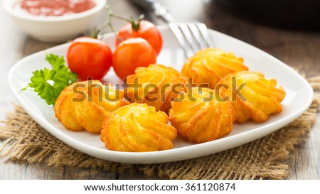 crunchy homemade pommes duchesse server on a plate - stock photo