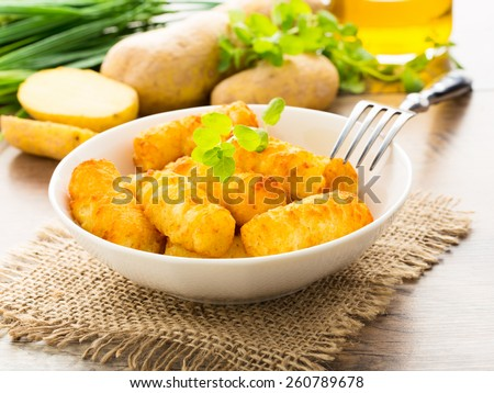crunchy homemade potato croquettes served in a bowl. - stock photo