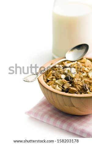 crunchy muesli in wooden bowl on white background - stock photo