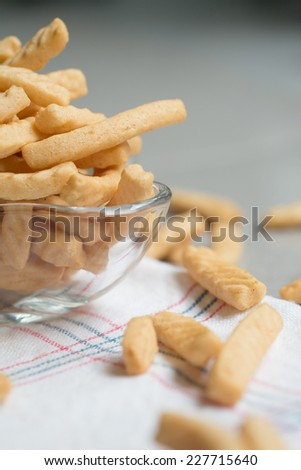Crunchy prawn crackers in a glass cup