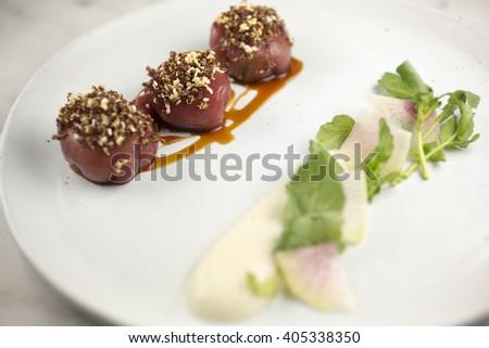 Crunchy tuna, avocado, white soy and red quinoa  - stock photo