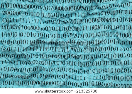 Crushed blue paper with binary code. Closeup. - stock photo