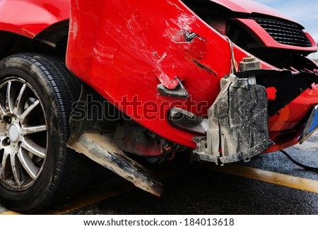 Crushed car - stock photo
