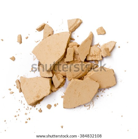 crushed cosmetic powder on white background