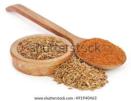 Crushed cumin with whole over white background