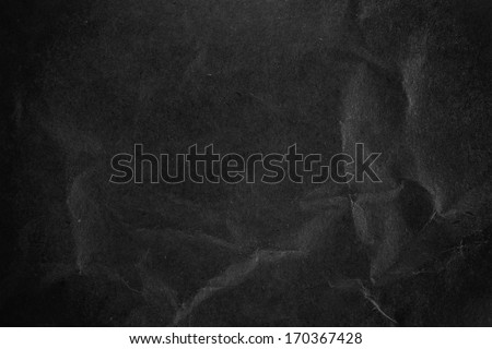 Crushed dark black  paper surface - stock photo