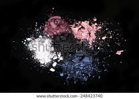 Crushed Eye Shadow Sets on Black Background - stock photo