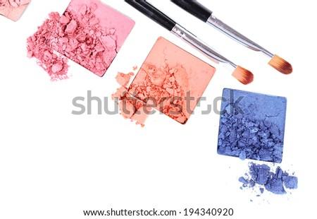 Crushed eyeshadow with brush isolated on white  - stock photo