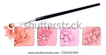 Crushed eyeshadow with brush isolated on white  - stock photo