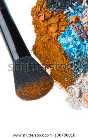 crushed eyeshadows with brush isolated on white background - stock photo