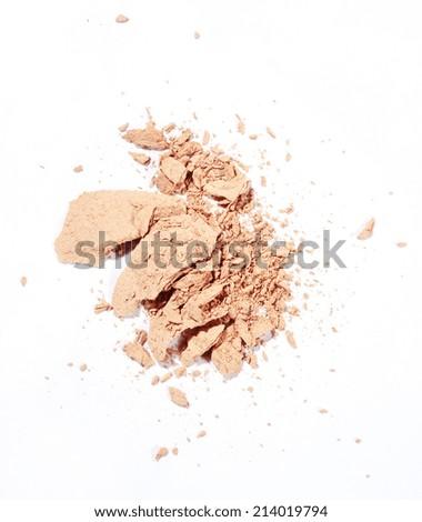 crushed face powder over white background - stock photo