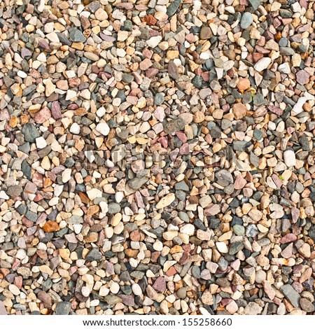 Crushed granite and pebble gravel texture - stock photo