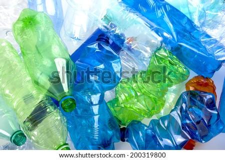 crushed multicolored plastic bottles  background - stock photo