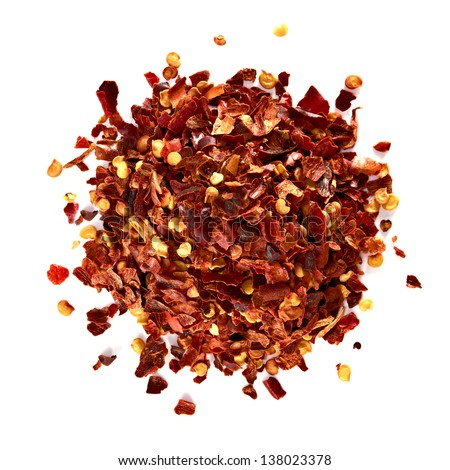Crushed pimienta roja red pepper pile from top on white background