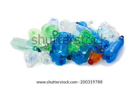 crushed plastic bottles on a white background - stock photo