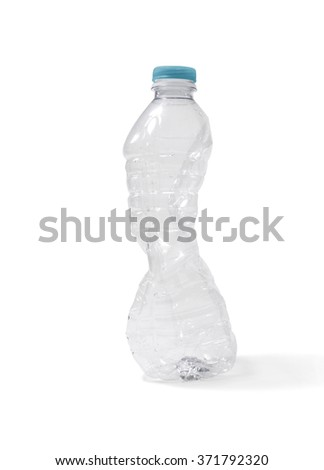 Crushed plastic water bottle - stock photo