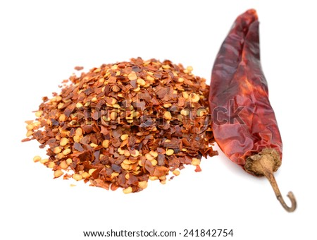 Crushed red pepper pile on white background - stock photo