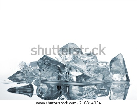 crushed translucent  blue-grey ice on bright reflection table on white background - stock photo