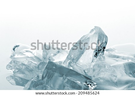 crushed translucent  ice on white background - stock photo